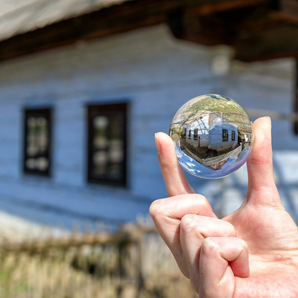 Reflection in crystal lensball at open-air museum of slovak village in Martin