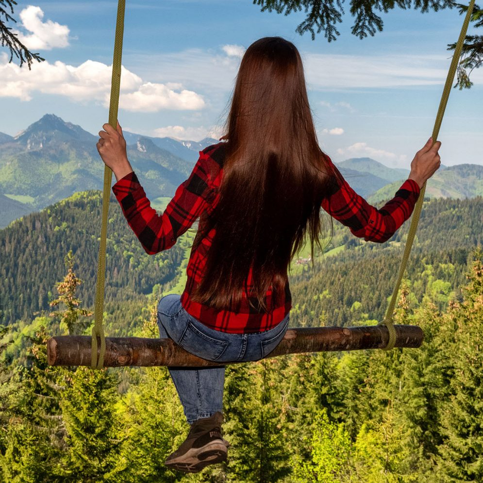 Rope tree swing in Zázrivá with a view of Malá Fatra mountains
